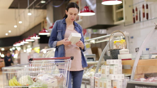 Pregnant woman grocery shopping