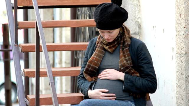 Pregnant woman in the city