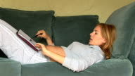 Pregnant woman on the sofa