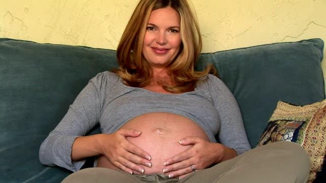 Pregnant woman on the sofa