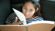 Pregnant woman reading the book