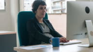 Pregnant woman working at office