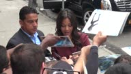 Pregnant Zoe Saldana arrives at the Good Morning America show and signs for fans before going in Celebrity Sightings in New York on July 28 2014 in...