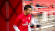 Arsenal FC training general views ENGLAND London Emirates Stadium EXT Arsenal players introduced onto pitch including Thomas Vermaelen Philippe...