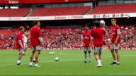 Arsenal FC training general views General views Robin van Persie / Small circle of players kicking ball including shots of Eduardo Vela / Vito...