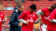 Arsenal FC training general views Various shots of Arsenal squad jogging around pitch as fans cheer from stands including focus shots on Carlos Vela...