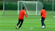 Arsenal squad training Jack Wilshere kicking ball to teammate Wenger watches Fabregas and Robin van Persie training Fabregas and van Persie training...
