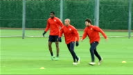 Arsenal squad training Wenger watches Arsenal players train including Fabregas Gallas Song and Silvestre Closeup of Wenger More of Arsenal players...