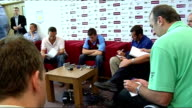Aston Villa press conference Milner sitting on chair talking to reporters Milner posing with Aston Villa shirt