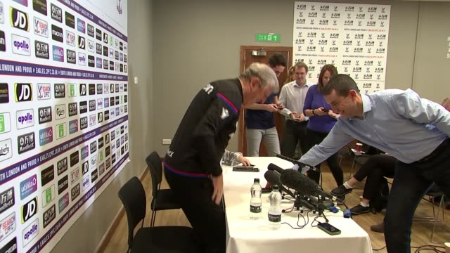 Crystal Palace struggling ENGLAND London INT Roy Hodgson arriving at press conference and taking seat Roy Hodgson press conference SOT Hodgson at...