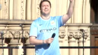 Manchester City victory parade Ground shots ENGLAND Manchester EXT **Music heard intermittently SOT** Crowd of Manchester City fans gathered to...