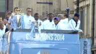 Manchester City victory parade Ground shots Manchester City players on opentop bus for victory parade / bus along in victory parade / players...