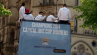 Manchester City victory parade Ground shots **Music heard intermittently SOT** Crowd of Man City fans / road sign 'Albert Square' / Manchester City...