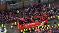 Manchester United victory parade Air views parade AIR VIEWs open topbus with 'Alexander The Great' banner held by fan in crowd / players onto bus /...