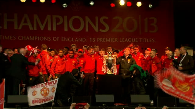 Manchester United victory parade GVs parade Players and Ferguson lifting Premier League trophy as 'We are the Champions' song played SOT / Fans...