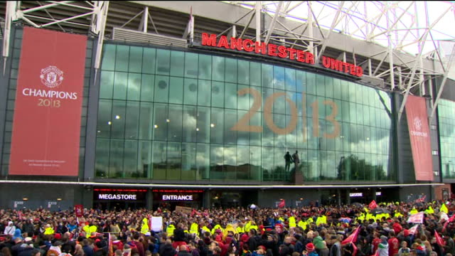 Manchester United victory parade Opentop bus ENGLAND Manchester Old Trafford EXT Various crowds gathered outside Old Trafford stadium