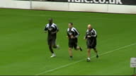 Newcastle United training ENGLAND Newcastle St James' Park EXT Newcastle United squad on pitch training Michael Owen running round pitch Jonas...