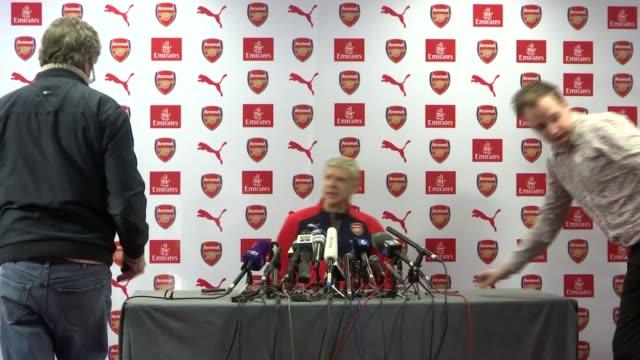 Preview of Arsenal v Tottenham Hotspur Hertfordshire London Colney INT Arsene Wenger arriving at press conference Arsene Wenger press conference SOT...