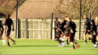 Tottenham Hotspur training ENGLAND Essex Chigwell EXT Tottenham Hotspur footballers practising ball skills in a group including Aaron Lennon and...