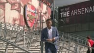 Premier League transfer deadline day ENGLAND London Emirates Stadium EXT Reporter to camera Reflection of Arsenal logo in puddle on ground Robbie...