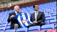Wigan unveil Martinez as manager ENGLAND Wigan JJB Stadium EXT Dave Whelan and Roberto Matinez pose with Wigan shirt whilst sitting in stand Closeup...