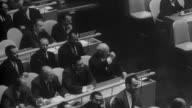Premiere Nikita Khrushchev of USSR stands up arguing at UN meeting / British prime minister Macmillan talking at podium / Secretary General Dag...