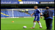EXT Andriy Shevchenko posing on pitch with football for photocall