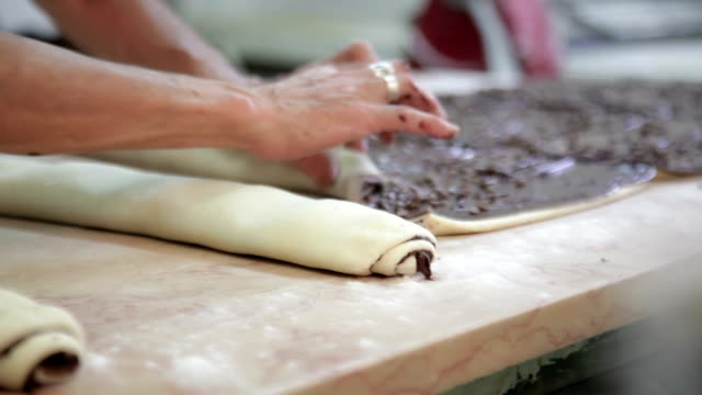 Preparation of roll with poppy filling