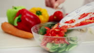 Preparation of vegetable salad from cucumbers tomatoes cabbage