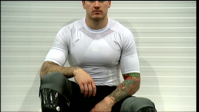 Preparations for elections / Aftermath for returning British troops WALES Cardiff INT Stephen Handley TILT DOWN prosthetic limbs with interview...