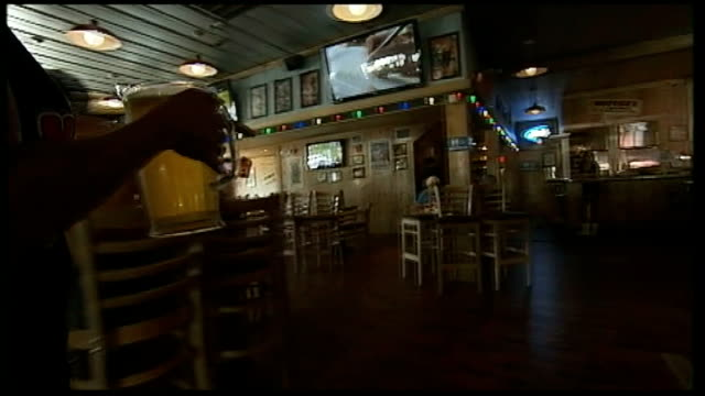 Preparations for Republican national convention in Florida Florida Tampa Vox pops Waitress behind counter in Hooters restaurant Waitress carrying...