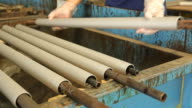Prepare an iron core to wrap rubber in printing factory