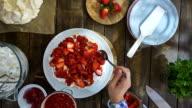 Preparing Berry Pavlova Cake with Strawberries and Raspberries