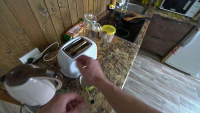 POV of preparing breakfast and pouring tea