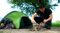 Preparing firewood in a campsite