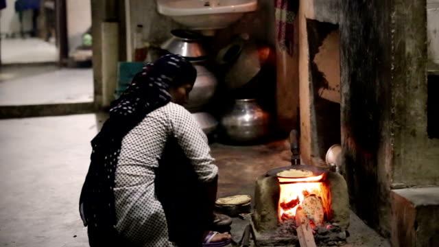 Preparing food on mud stove