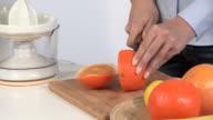 Preparing freshly squeezed orange juice
