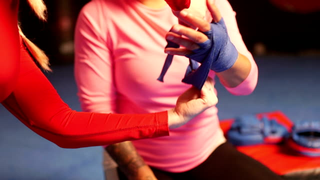 Preparing Her Hands For Boxing