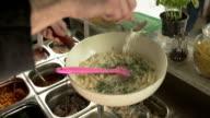 Preparing Pasta in a Food Bar
