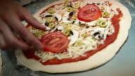 Preparing pizza