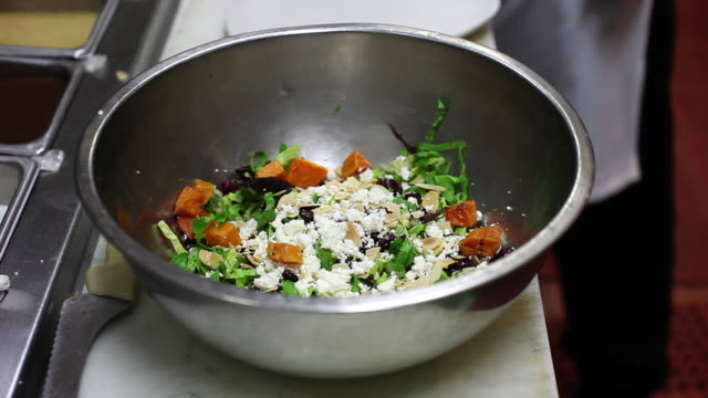 CU Preparing salad in kitchen / Truxton's, California, USA