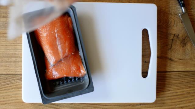 preparing salmon fillet