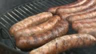 Preparing sausage at Kreger's