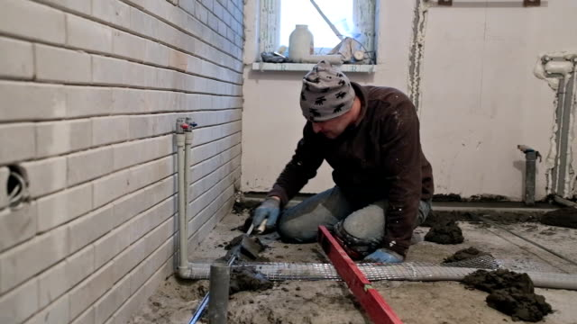 Preparing the floor for pouring concrete.