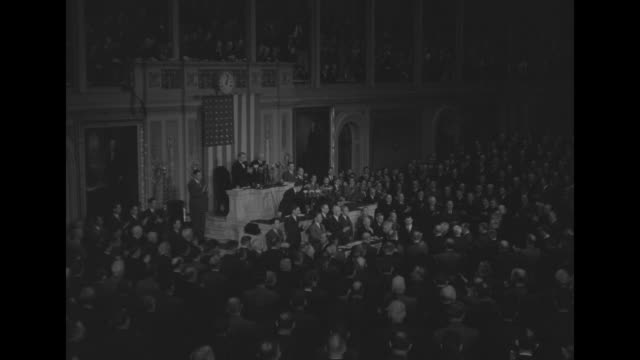 VS Pres Harry Truman walks to rostrum of House of Representatives chamber as Congressmen give standing ovation he turns to President of Senate Sen...