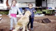 Preschool Children Camping with Dog