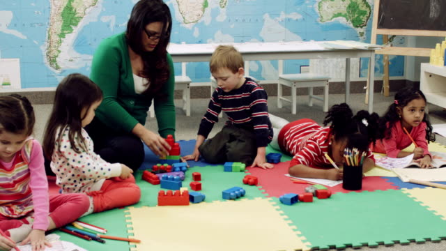 Preschoolers playing with blocks at a daycare center