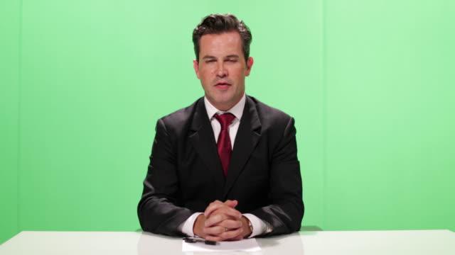 Presenter in a green screen studio
