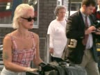 TV presenter Paula Yates arrives at Heathrow and pushes baggage cart through arrivals area to taxi The former wife of Bob Geldof subsequently died of...