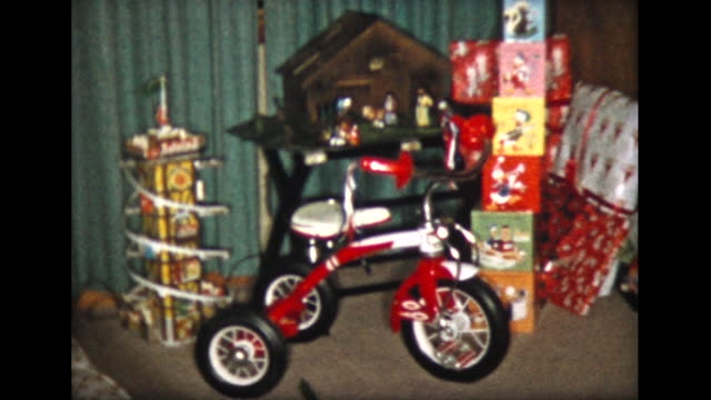 1957 presents under Christmas tree